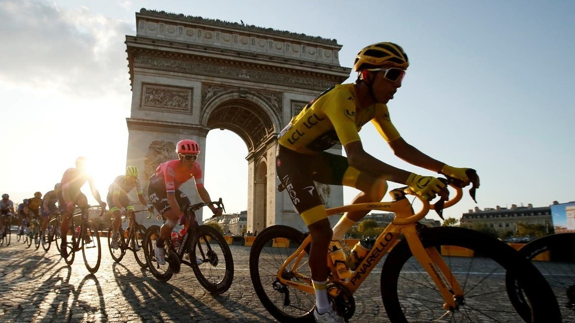 Team INEOS rider Egan Bernal of Colombia, wearing the overall leader's yellow jersey, in action in front of the Arc de Triomphe. (AFP)