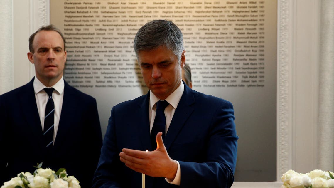 Ukraine's Foreign Minister Vadym Prystaiko lights a candle during a moment of silence for those killed on the Ukrainian International Airlines flight in London, UK, January 16. (Reuters)
