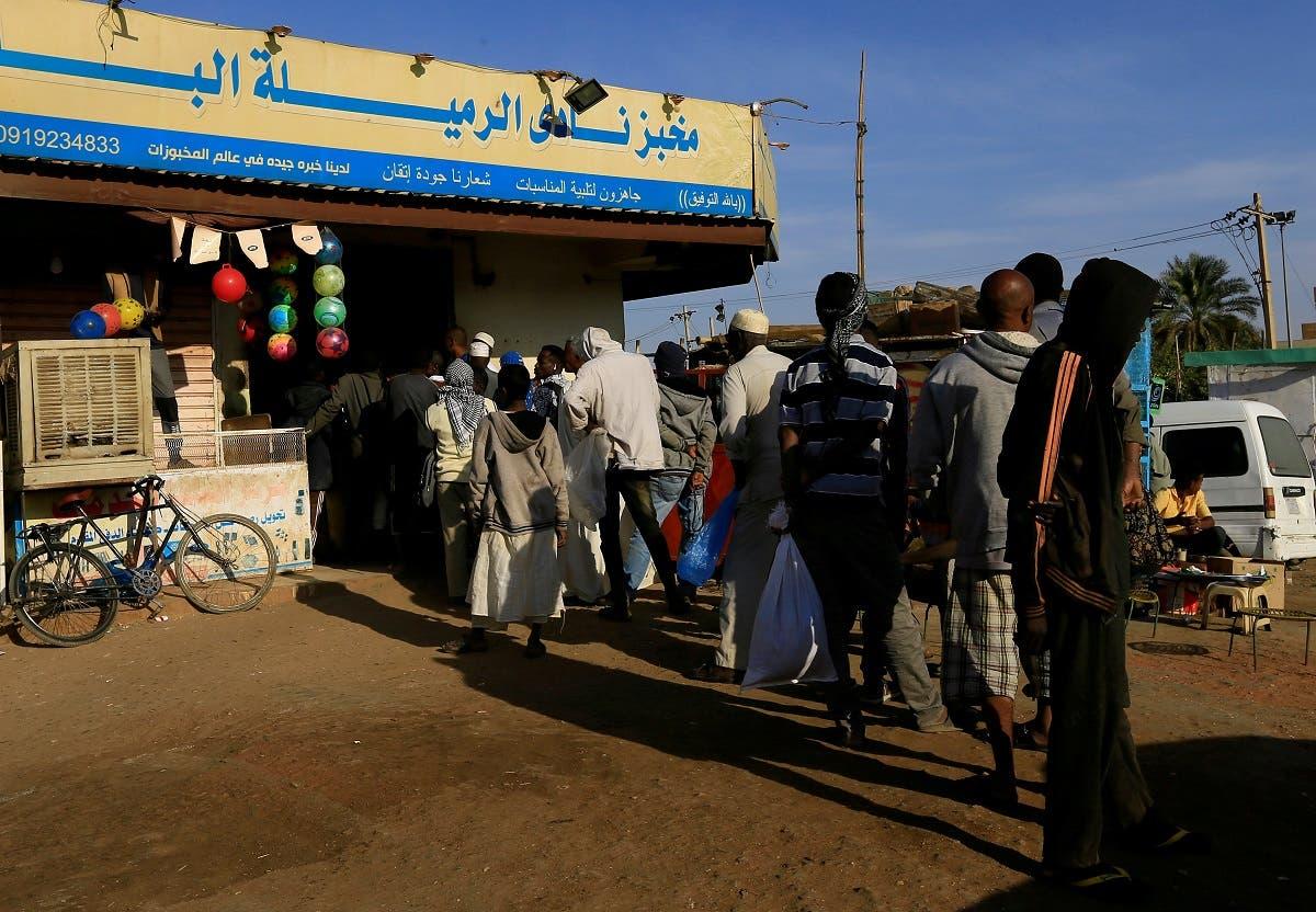 Customers queue to buy bread at a bakery in Khartoum, Sudan February 19, 2020. (Reuters)