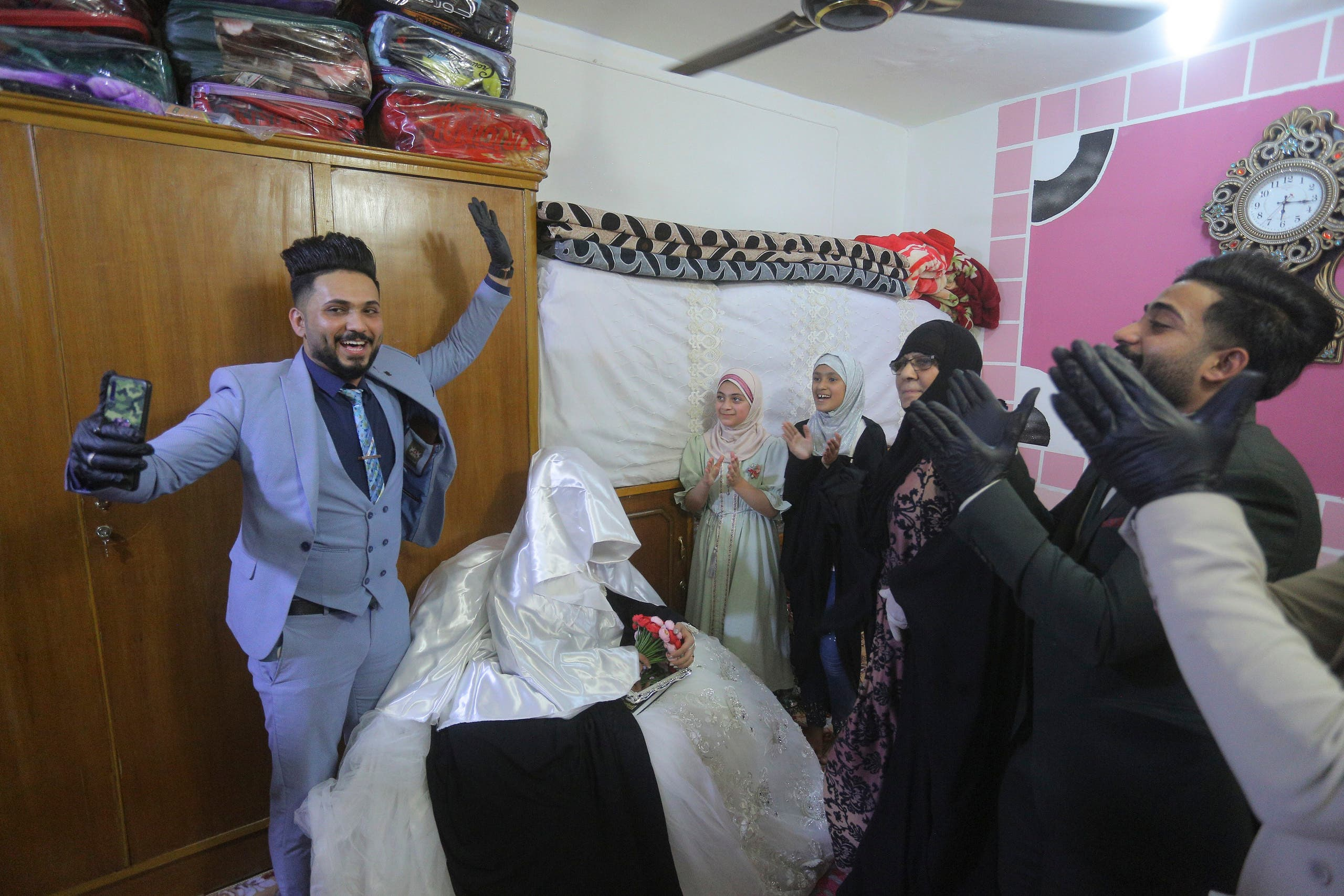 Ahmed Khaled al-Kaabi and his bride Ruqaya Rahim celebrate their wedding in Najaf, Iraq, on Thursday, April 9, 2020. (AP)