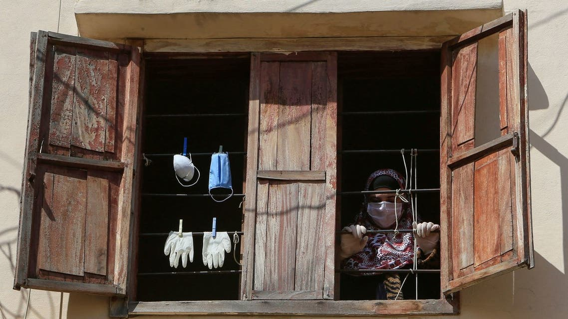 Gloves and face masks are hanged to dry during a countrywide lockdown to combat the spread of the coronavirus disease (COVID-19) in Sidon, Lebanon. (Reuters)