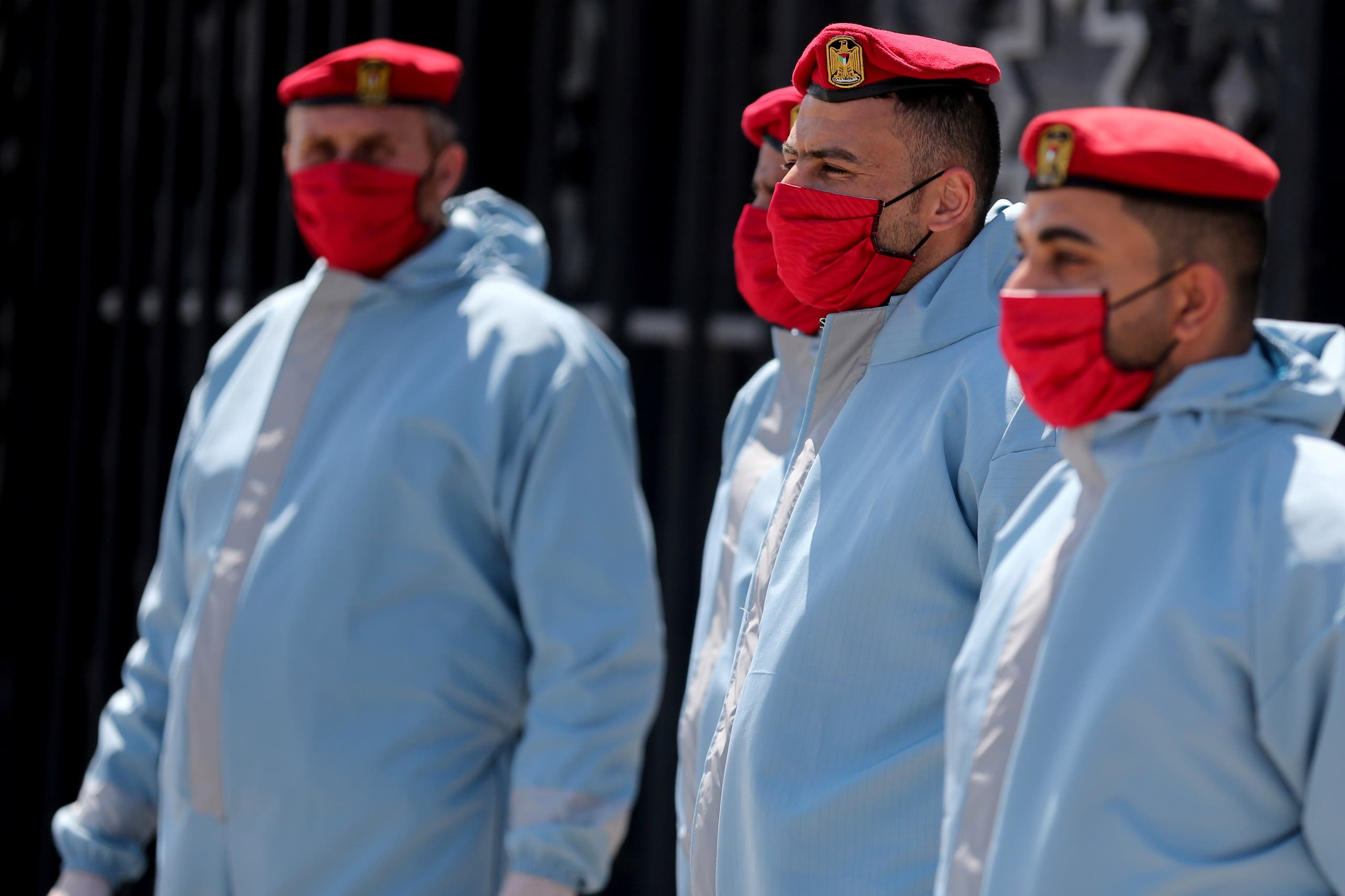 Members of Palestinian Hamas security forces wear protective gear as precaution against the coronavirus at Rafah border crossing in the southern Gaza Strip on April 13, 2020. (Reuters)