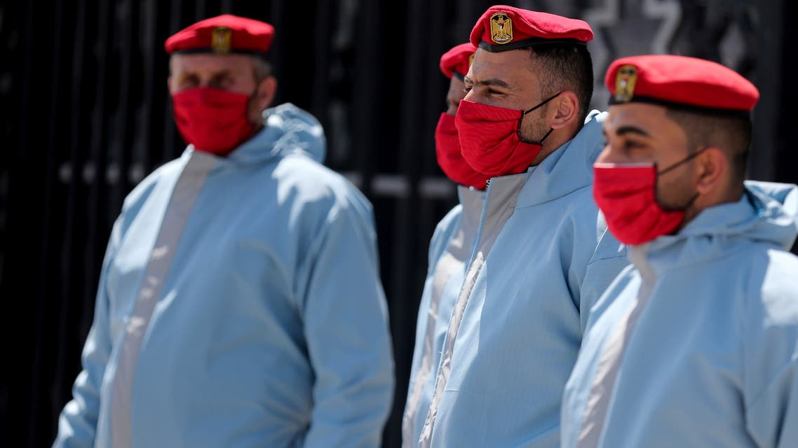 Members of Palestinian Hamas security forces wear protective gear as precaution against the coronavirus disease (COVID-19), at Rafah border crossing in the southern Gaza Strip April 13, 2020. REUTERS
