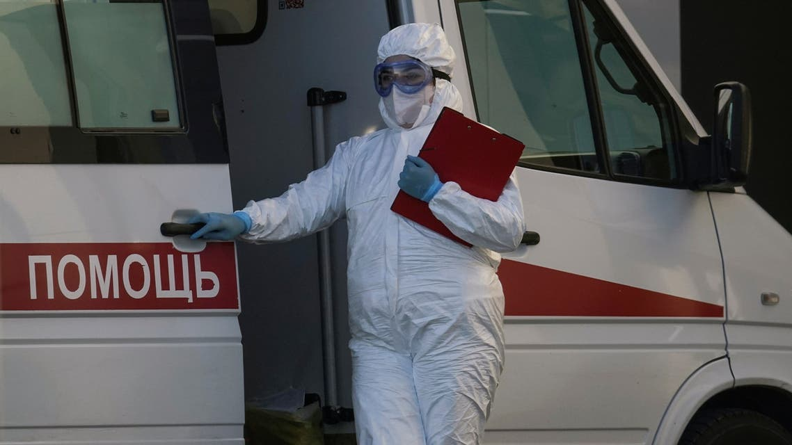 A medical specialist stands outside a hospital for patients infected with the coronavirus disease on the outskirts of Moscow. (Reuters)