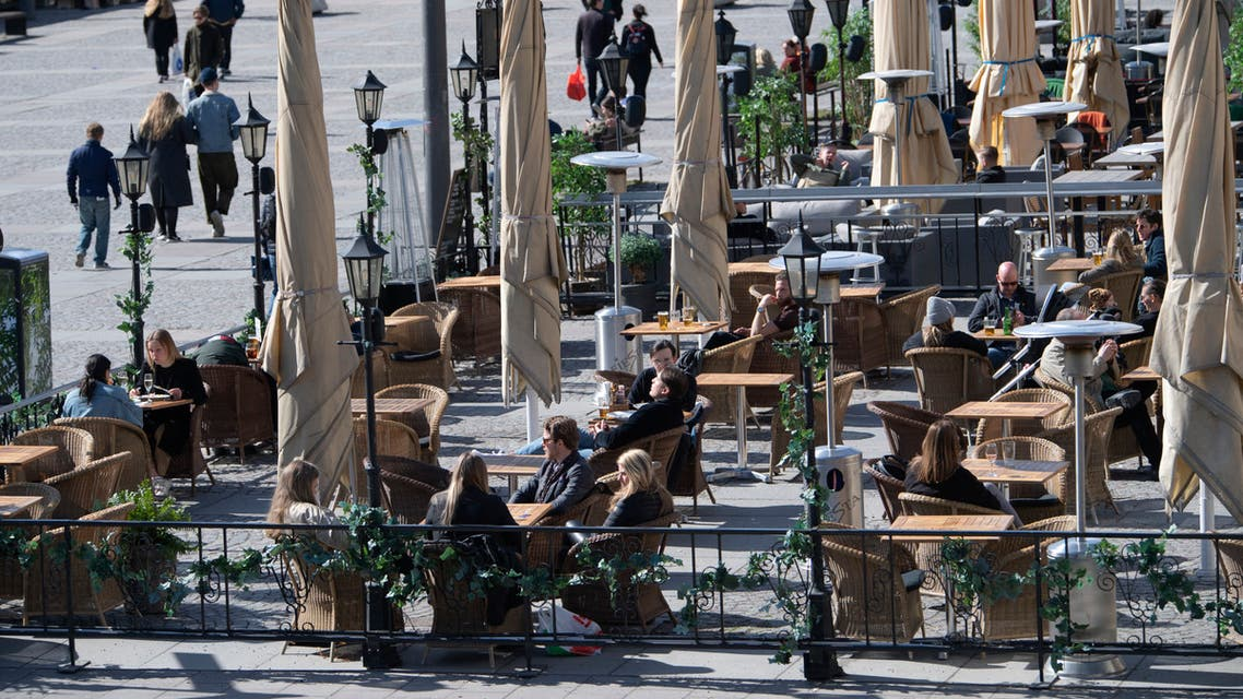 People sit at a cafe terrasse in central Stockholm, Sweden, on April 11, 2020 amid the new coronavirus COVID-19 pandemic. afp