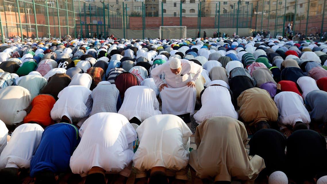 Worshippers attend the Eid al-Fitr prayers in an open field in Amman, Jordan on July 17, 2015. (AP)