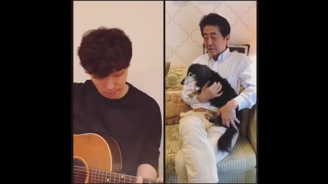 Musician Gen Hoshino (L) and Japanese Prime Minister Shinzo Abe (R) in video posted by the PM. (Twitter/Screengrab)