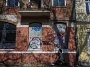 """""""ارفعوا رؤوسكم"""".. كورونا يحول شرفات برلين لأعمال فنية"""