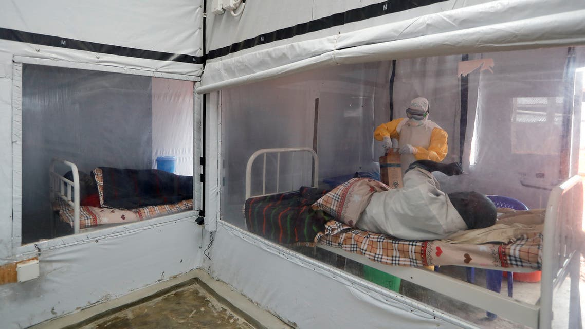 Moise Vaghemi, 33, a father of two children and an Ebola survivor who works as a nurse, tends to a patient who is suspected to be suffering from Ebola, inside the Biosecure Emergency Care Unit (CUBE) at an Ebola treatment centre (ETC) in Katwa, near Butembo, in the Democratic Republic of Congo, October 3, 2019. Vaghemi Survived Ebola in August, 2019 after 16 days of treatment. For a long time, I was stigmatised. It's been a long time since I had any family member visit me, Vaghemi said. I was even accused of having received money to bring people from my community to the treatment centre, to kill them with the virus and then sell their organs abroad. REUTERS/Zohra Bensemra
