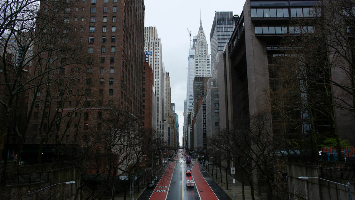 Cars cross 42th street as rain falls on March 28, 2020 in New York City. (AFP)