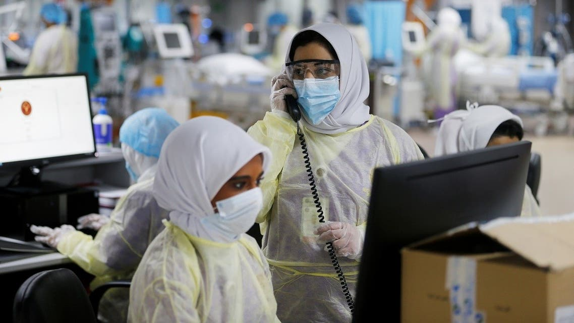 Doctors and nurses are seen doing their final check on the equipment in a makeshift ICU Field Intensive Care Unit 1 set up by Bahrian authorities to treat the coronavirus disease (COVID-19) critical patients, at a car-park of Bahrain Defence Force Hospital in Riffa. (Reuters)