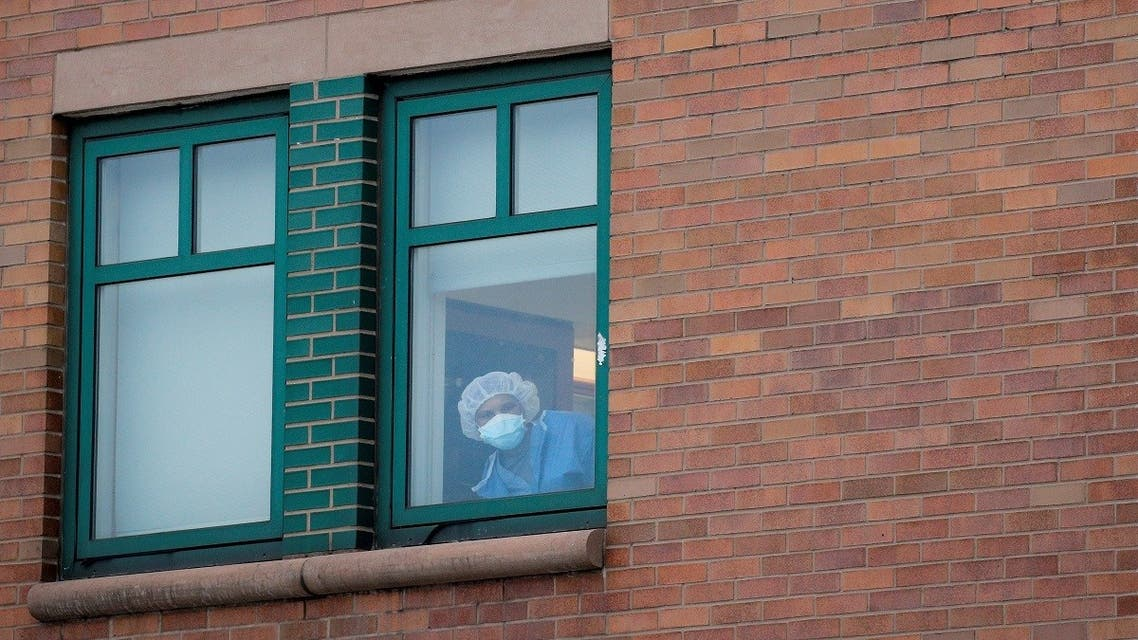 A healthcare worker looks out a window at the emergency center at Maimonides Medical Center during the outbreak of the coronavirus disease (COVID-19) in Brooklyn. (Reuters)