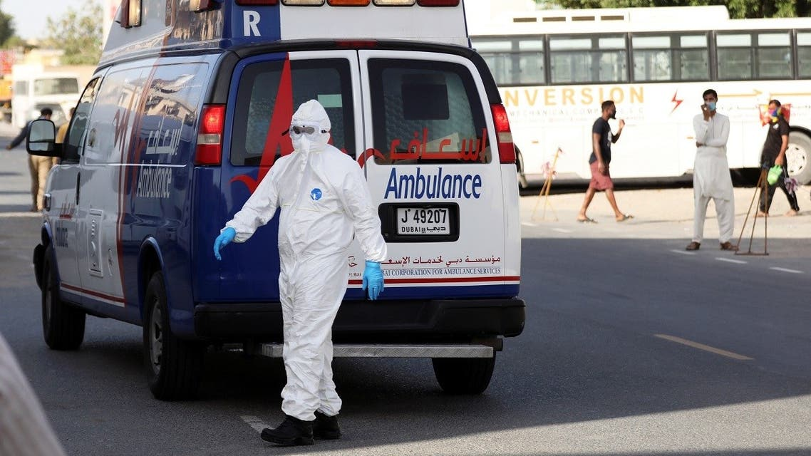 A first responder wearing a protective suit arrives to take a patient, following the outbreak of the coronavirus disease (COVID-19), in the Al Quoz industrial district of Dubai. (Reuters)