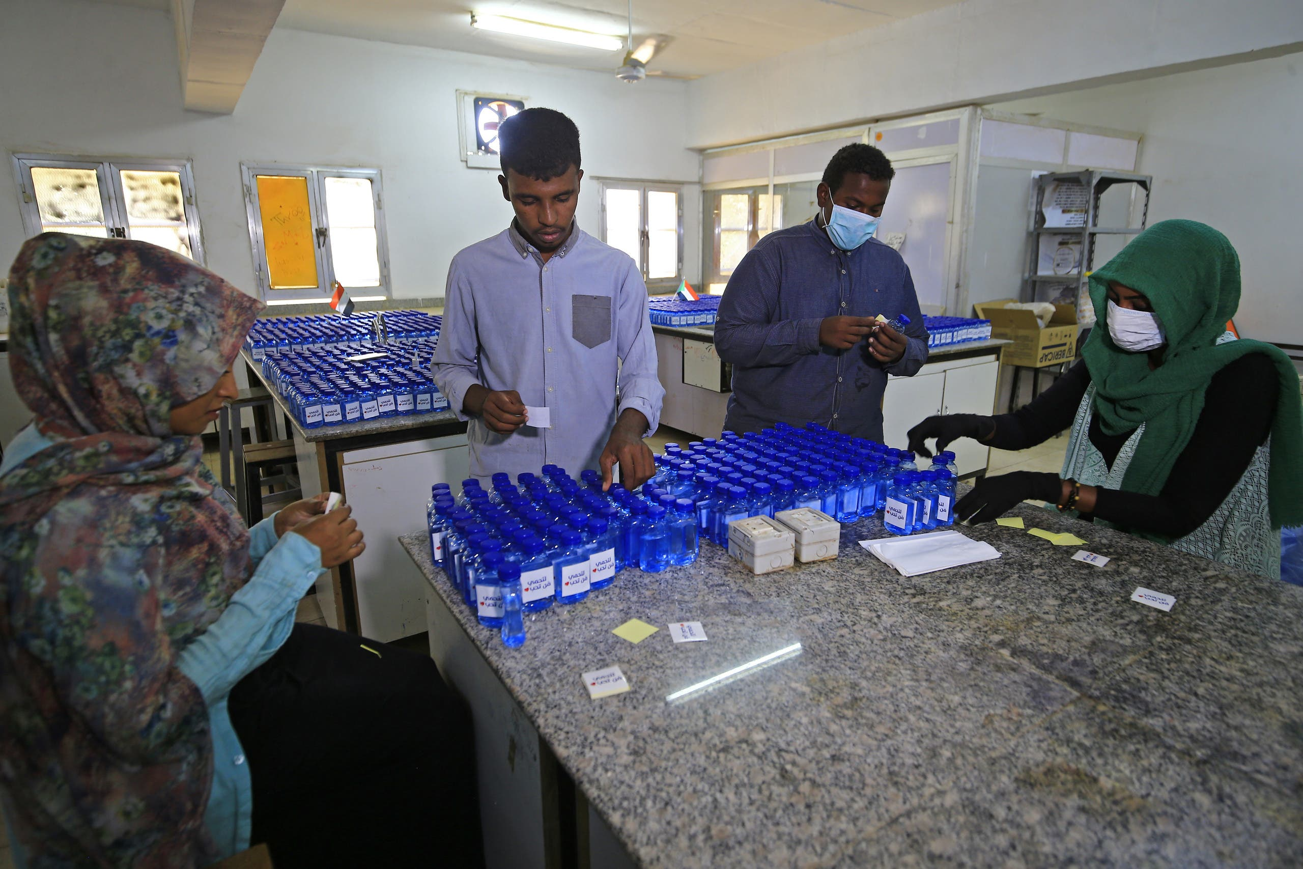 Sudanese medical laboratory students prepare sterilisers to combat the spread of the coronavirus COVID-19 in Khartoum. (AFP)