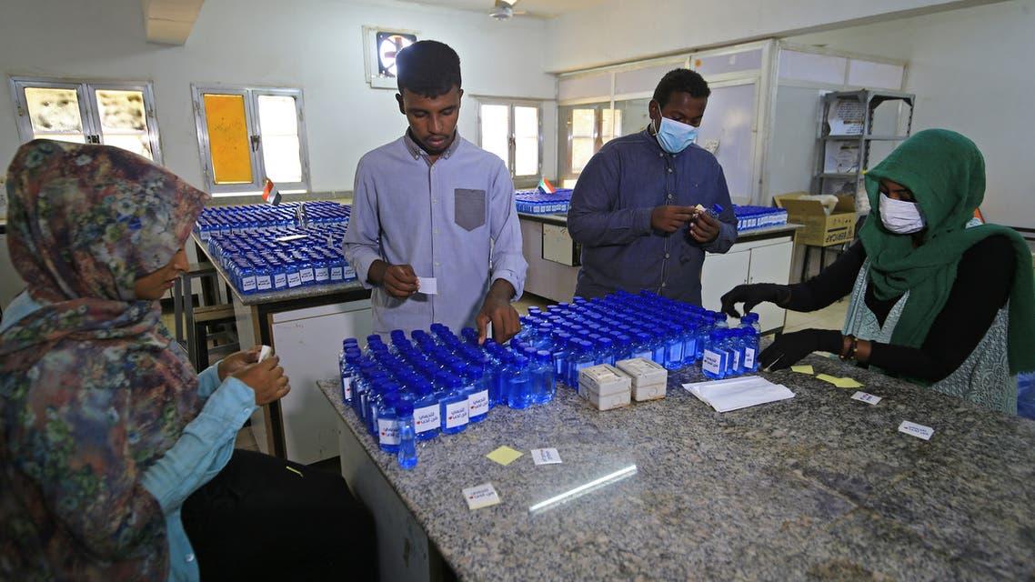 Sudanese medical laboratory students prepare sterilisers to combat the spread of the coronavirus COVID-19, on April 14, 2020 in Khartoum. (AFP)