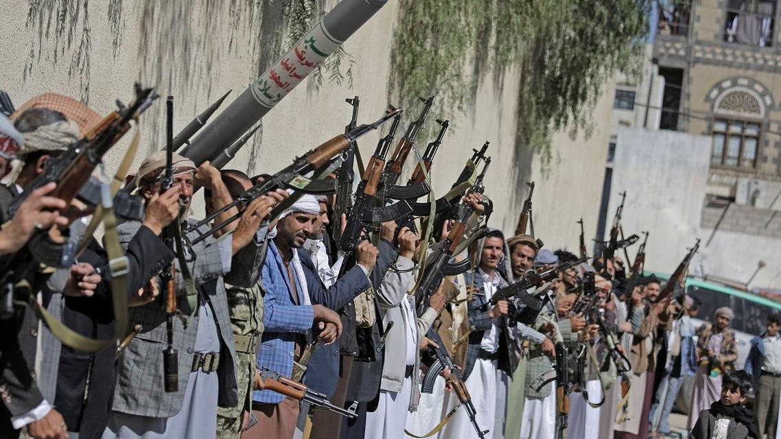 Tribesmen loyal to the Houthi rebels chant slogans as they hold their weapons during a gathering aimed at mobilizing more fighters for the Houthi movement in Sanaa, Yemen, Tuesday, Feb. 25, 2020. (AP)