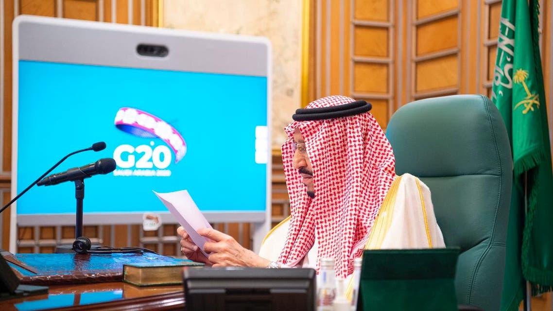 Saudi King Salman bin Abdulaziz speaks via video link during a virtual G20 summit on coronavirus disease (COVID-19), in Riyadh, Saudi Arabia, March 26, 2020. (Saudi Royal Court/Handout via Reuters)
