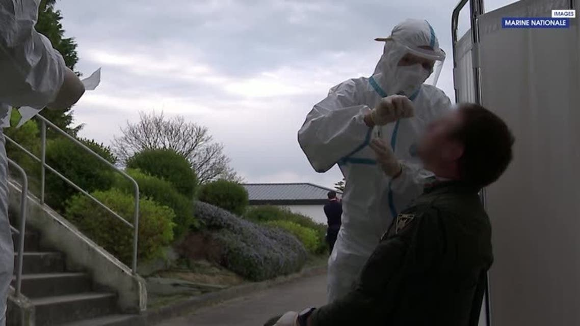 A screengrab of military personnel being tested for coronavirus aboard Charles de Gaulle aircraft carrier on April 13, 2020. (Reuters/Courtesy French Defense Ministry/ French Navy)