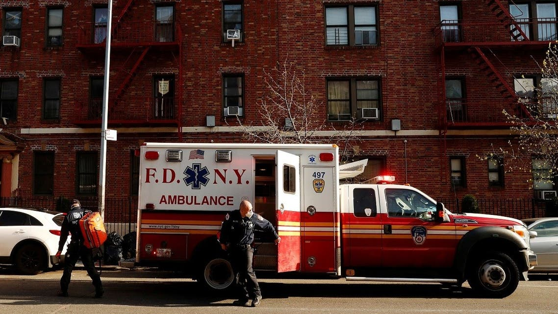 New York City Fire Department (FDNY) Emergency Medical Technicians (EMT) wearing personal protective equipment arrive to assist a woman who was having difficulty breathing during ongoing outbreak of the coronavirus disease. (Reuters)