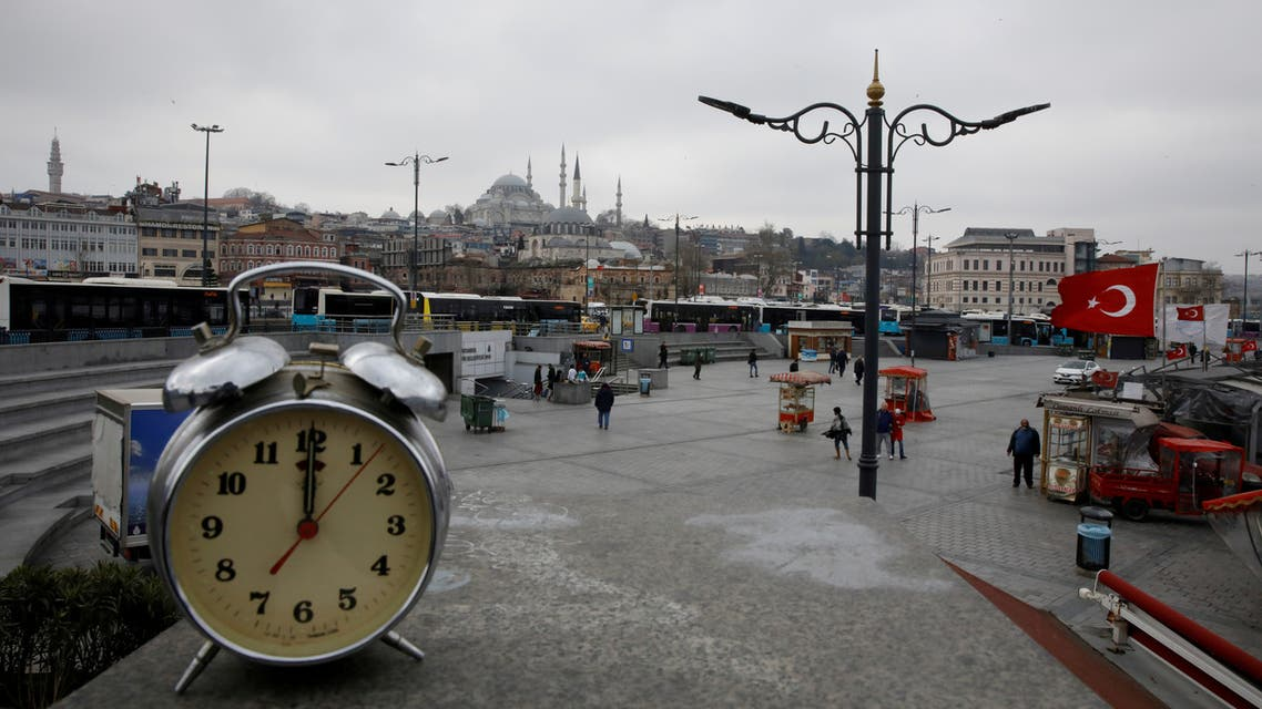 A clock showing the time at noon, is displayed for a photo at Eminonu district during the coronavirus disease (COVID-19) outbreak, in Istanbul,Turkey, March 31, 2020. (Reuters)