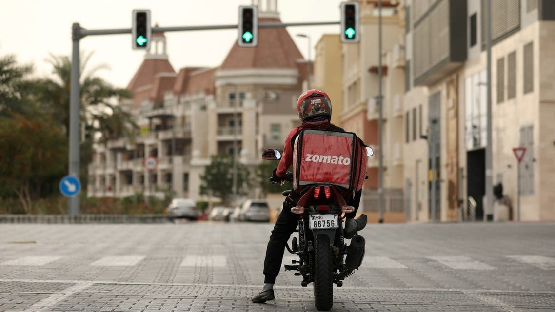 A delivery man drives a motorcycle, following the outbreak of coronavirus disease (COVID-19), in Dubai, United Arab Emirates, March 27, 2020. (Reuters)