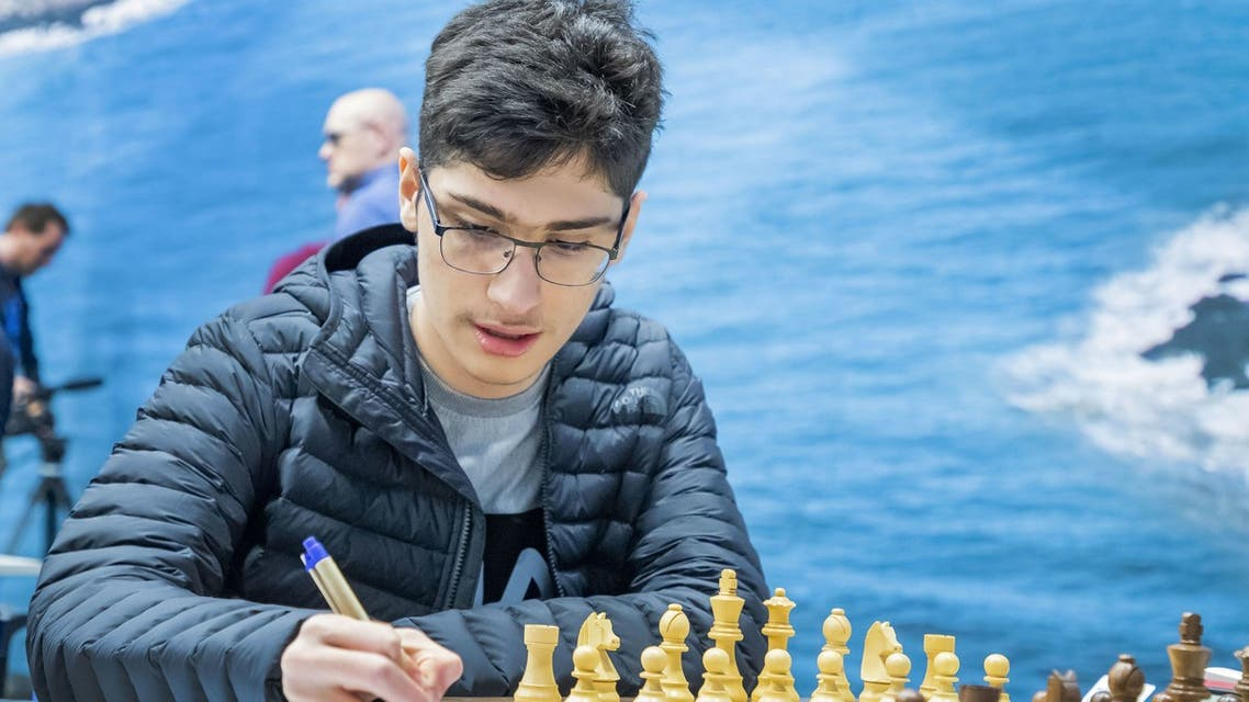 Iran's Alireza Firouzja plays against Belarus' Vladislav Kovalev during the first round of the 82nd edition of the Tata Steel Chess Tournament in Wijk aan Zee, The Netherlands, on January 11, 2020. (AFP)