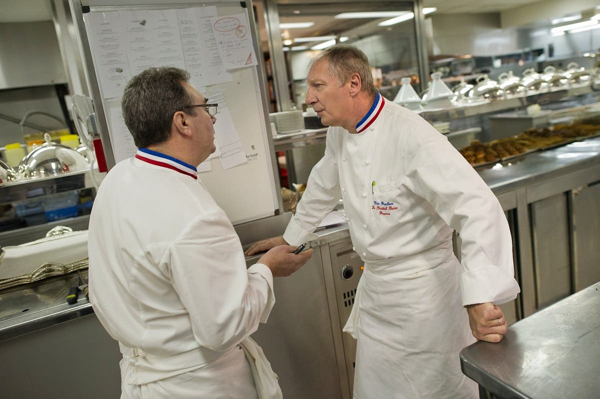 Head chef of the five-star luxury hotel Le Bristol in Paris Eric Frechon (R) speaks with his sous-chef Franck Leroy in the hotel's kitchen. (AFP)