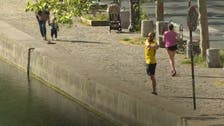 Coronavirus: Joggers, walkers get last exercise in before daily confinement in Paris