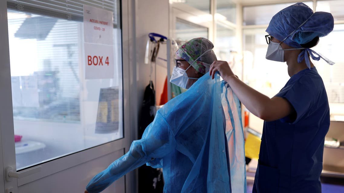 A medical staff member gets ready to work in an intensive care unit for coronavirus disease (COVID-19) patients at the Clinique de l'Orangerie private hospital in Strasbourg, as the spread of the coronavirus disease continues, France April 17, 2020. REUTERS/Christian Hartmann