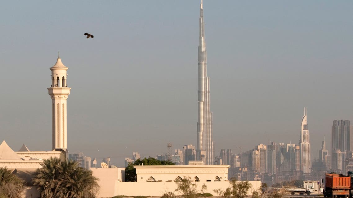 A mosque is seen in front of the world's tallest building Burj Dubai during the Eid al-Adha holiday in Dubai. (Reuters)