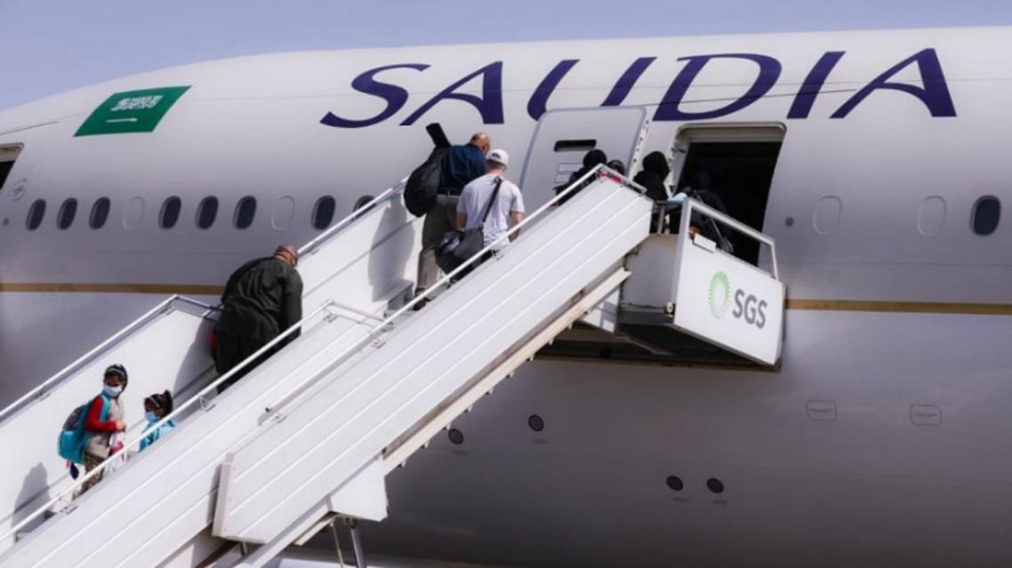 Saudi Arabia citizens board a Saudi Airlines plane flying back to the Kingdom. (SPA)
