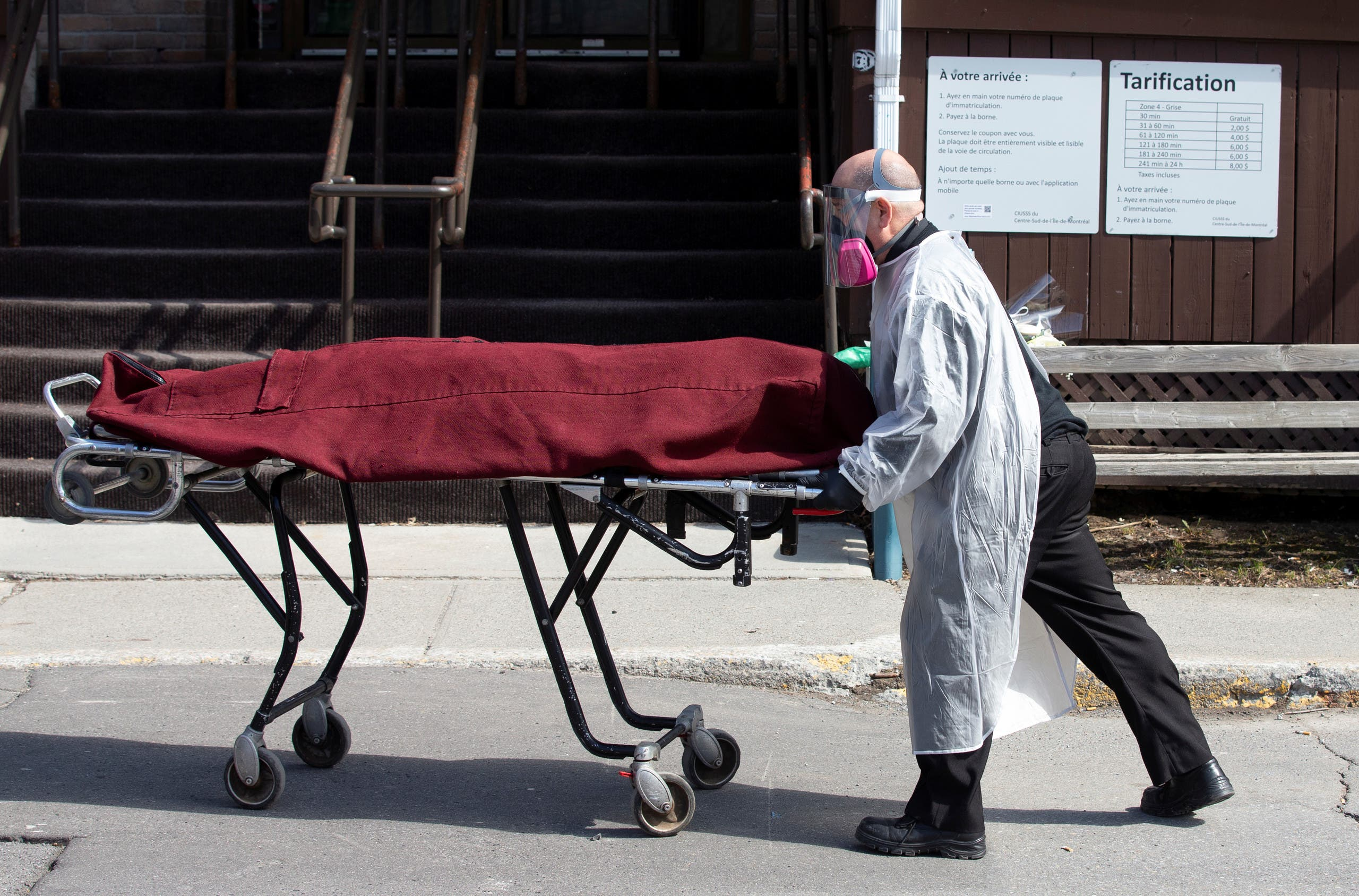 A body is removed from Centre d'hebergement Yvon-Brunet, a seniors' long-term care centre, amid the outbreak of the coronavirus disease (COVID-19), in Montreal, Quebec, Canada April 18, 2020. (Reuters)