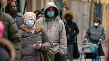 As US lifts mask requirements for vaccinated, some not ready to give up face covering