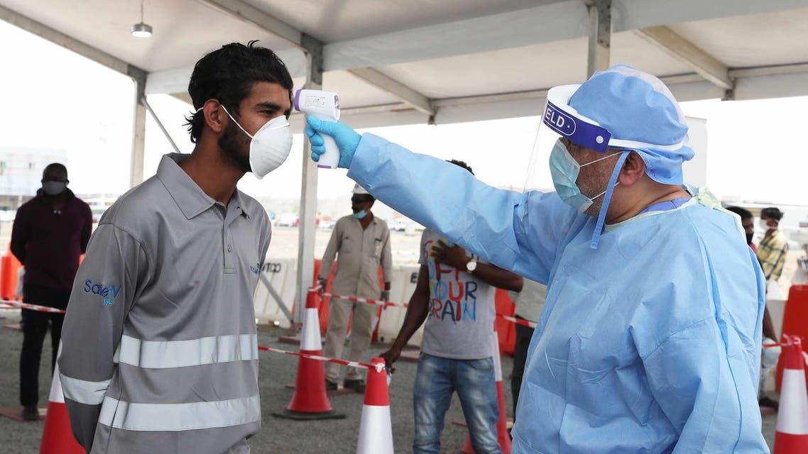 Abu Dhabi testing workers (WAM)