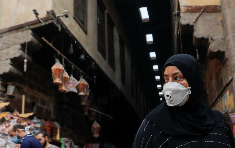 A woman wearing a protective face mask, amid concerns over the coronavirus, looks at traditional Ramadan lanterns, ahead of the Muslim holy month of Ramadan at Al Khayamia street in old Cairo, Egypt, April 16, 2020. (Reuters)