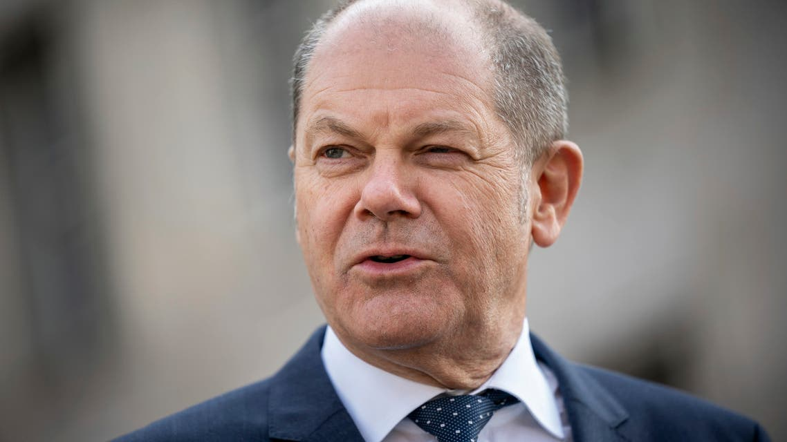 German Finance Minister Olaf Scholz briefs the media after Eurogroup negotiations in front of the finance ministry in Berlin, Germany, on Wednesday, April 8, 2020. (AP)