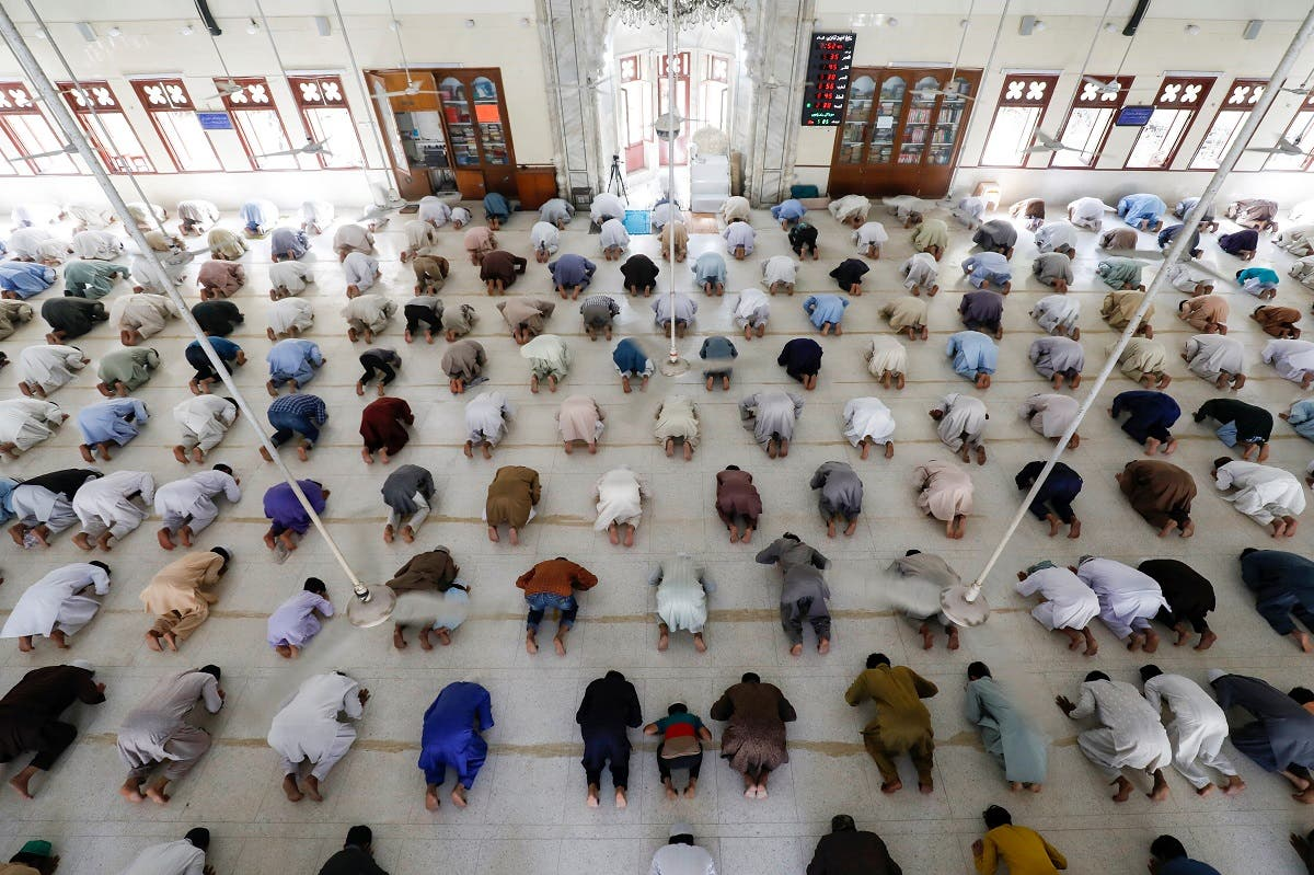 Muslims maintain safe distance as they attend Friday prayer after government limited congregational prayers and ordered to stay home, in efforts to stem the spread of the coronavirus disease (COVID-19), in Karachi, Pakistan. (Reuters)