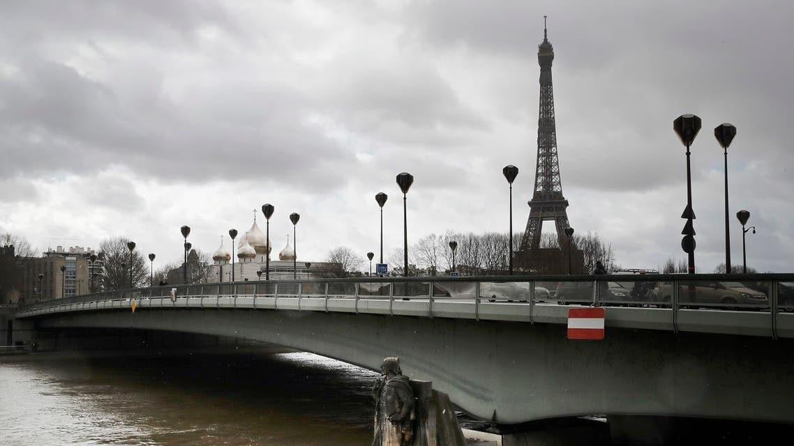 Water flows past Alma bridge by the Zouave statue which is used as a measuring instrument during floods in Paris. (AP)