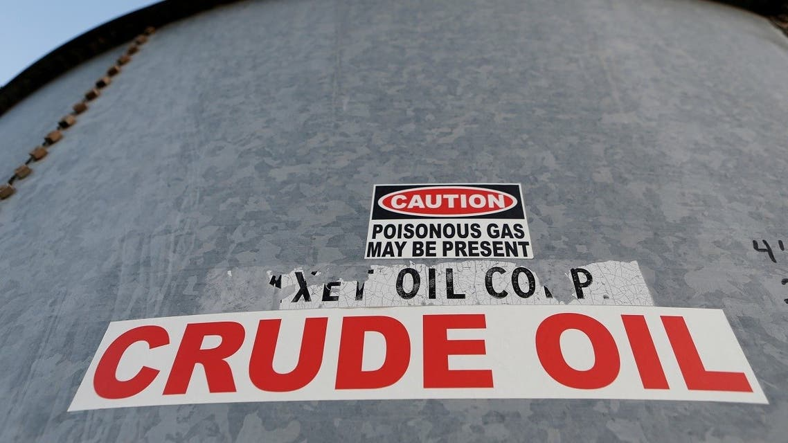 A sticker reads crude oil on the side of a storage tank in the Permian Basin in Mentone, Loving County, Texas, US. (Reuters)