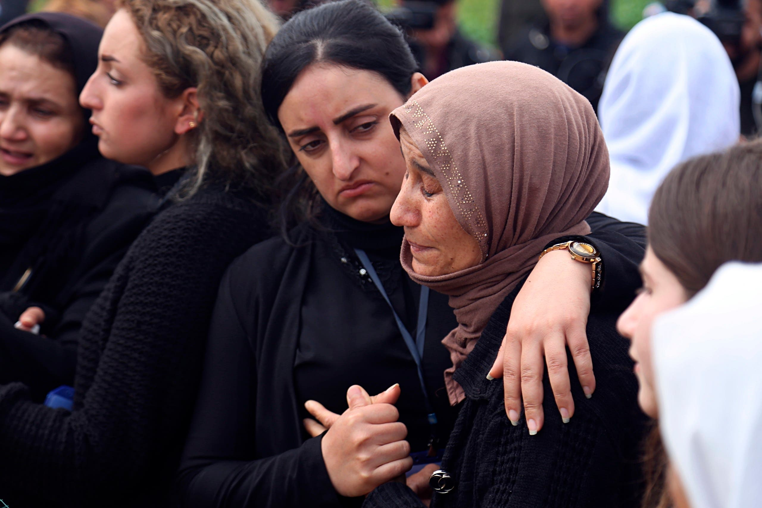 In this March 15, 2019 file photo, Iraqi Yazidi women mourn during the exhumation process of a mass grave in Iraq's northwestern region of Sinjar. (AP)