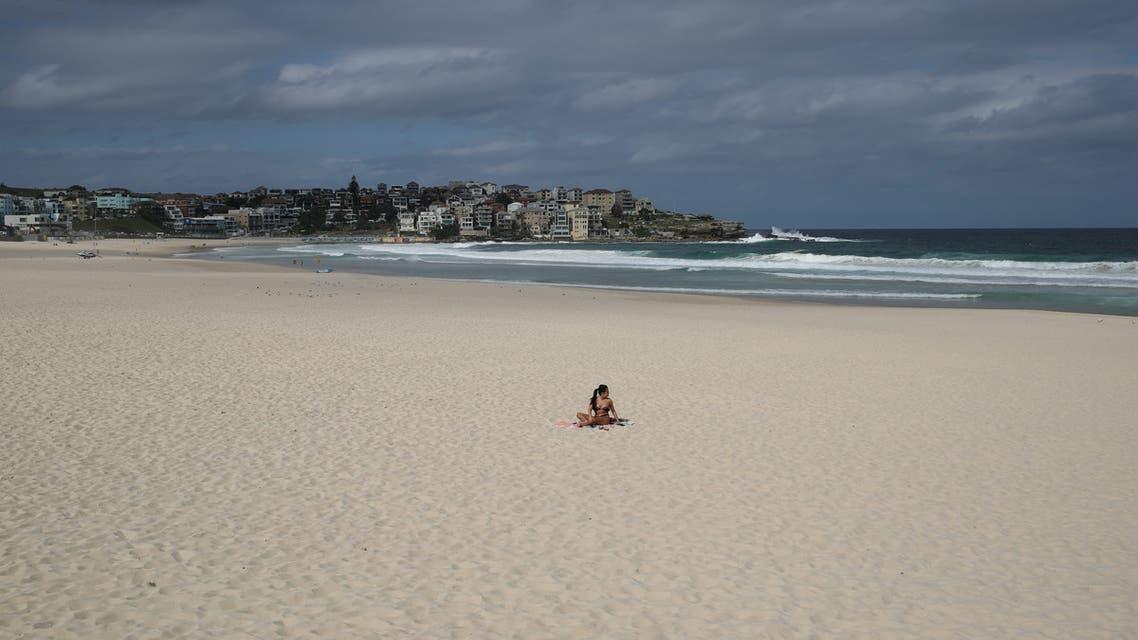 Single surfer on Australia's Bondi Beach after it was closed due to coronavirus. (Reuters)