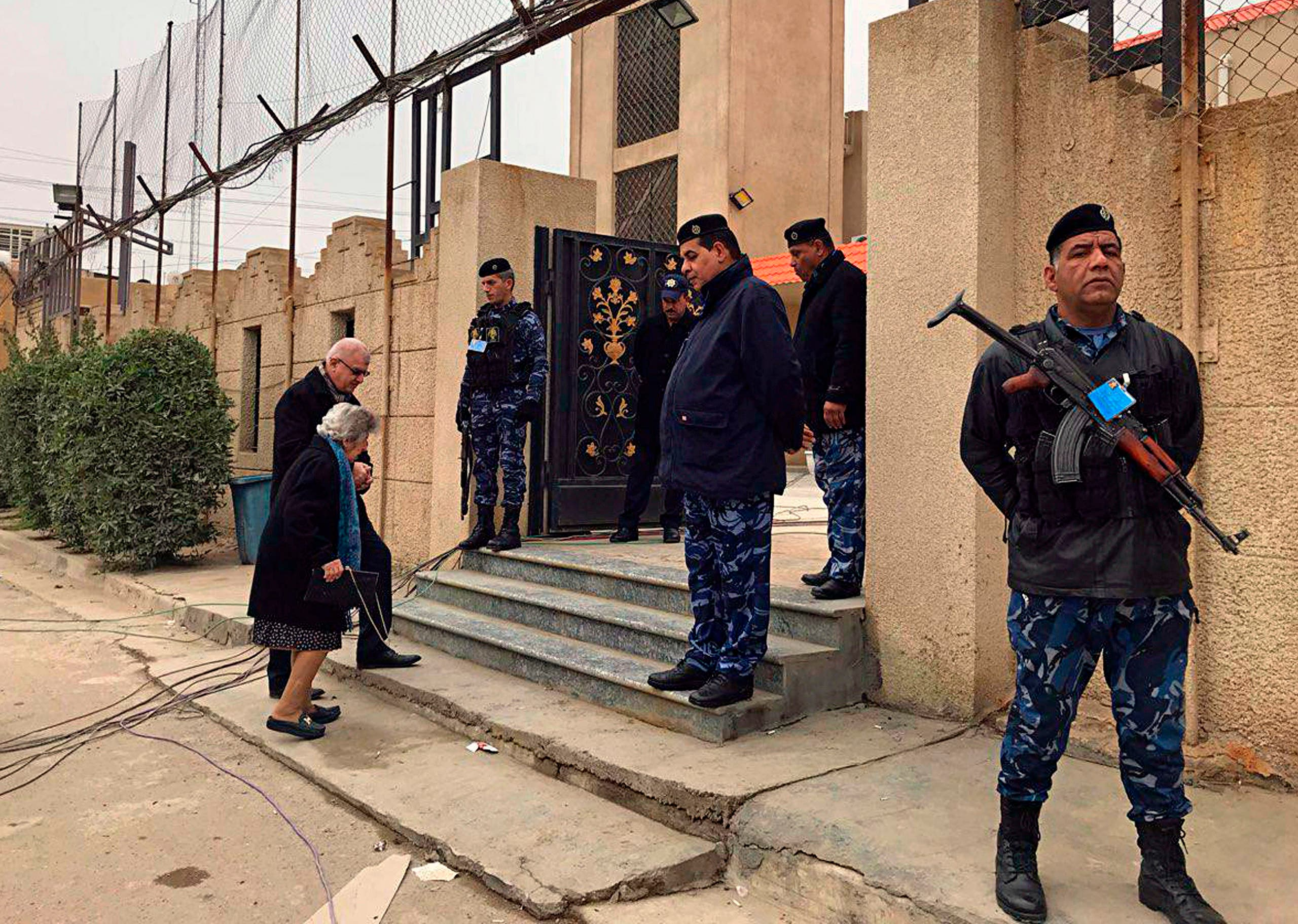 Security forces stand guard before Christmas Mass outside Mar Youssif Chaldean Church in Baghdad, Iraq on Dec. 25, 2018. (AP)