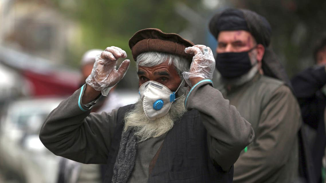 Daily-wage workers wear a protective face mask to help curb the spread of the coronavirus in Kabul, Afghanistan, Monday, April 20, 2020. (AP)