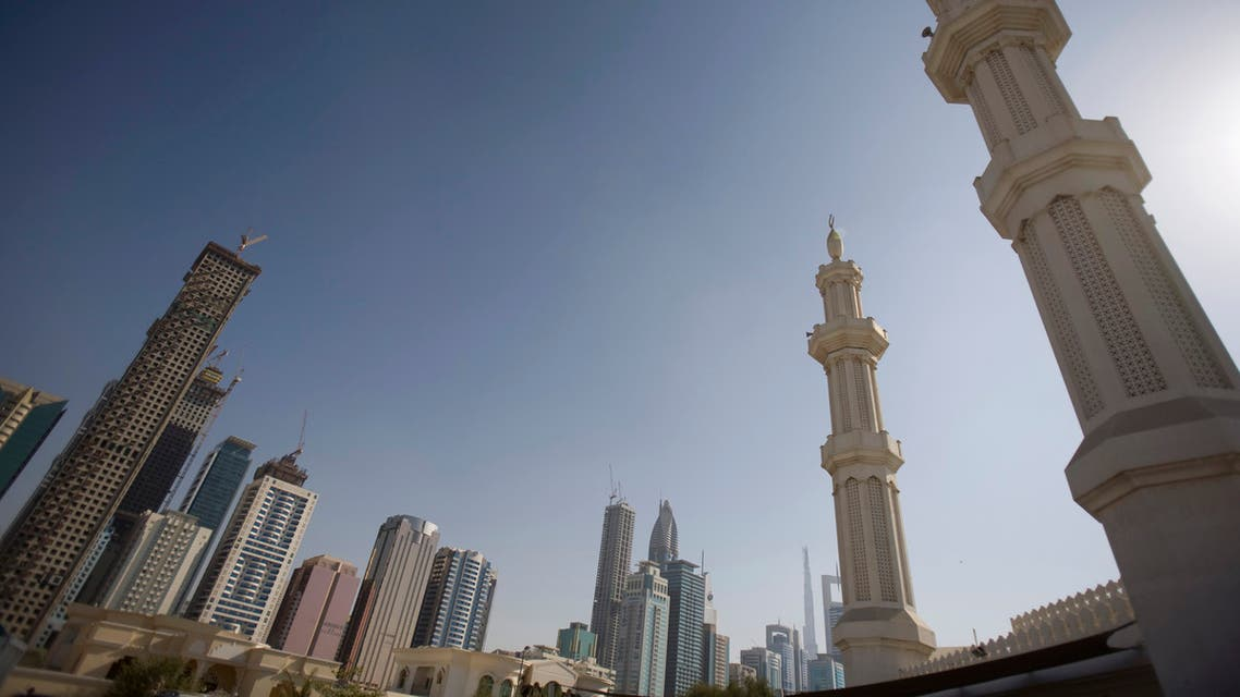 Minarets on a mosque are seen behind the booming real estate projects on the Sheikh Zayed highway in Dubai. (Reuters)
