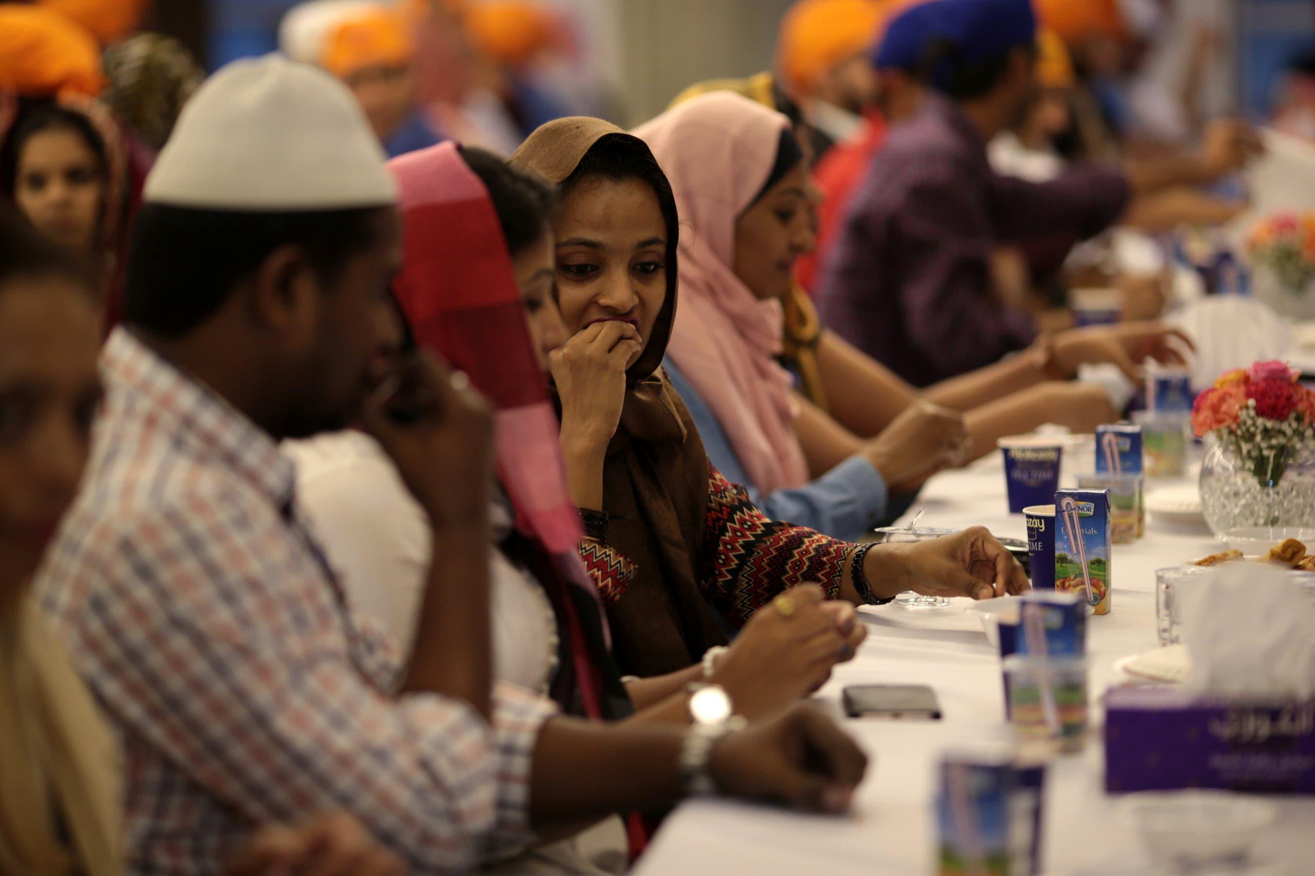 Muslims break their fast at the GuruNanak Darbar Sikh temple, during the Muslim holy month of Ramadan in Dubai. (File photo: Reuters)