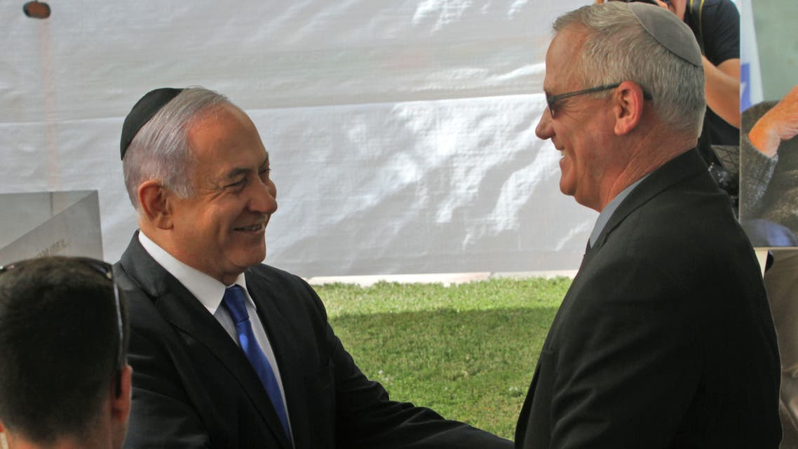Israeli Prime Minister Benjamin Netanyahu (L) greets Benny Gantz, leader of Blue and White party, at a memorial ceremony for late Israeli president Shimon Peres, at Mount Herzl in Jerusalem on September 19, 2019.