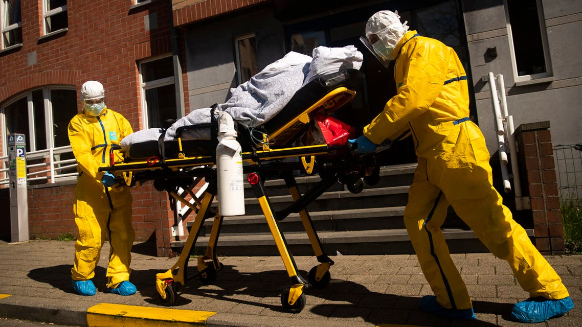 A coronavirus patient is transferred from a hospital to a home for elderly by members of the medical staff of Klinicare in Brussels on April 1, 2020. (AP)