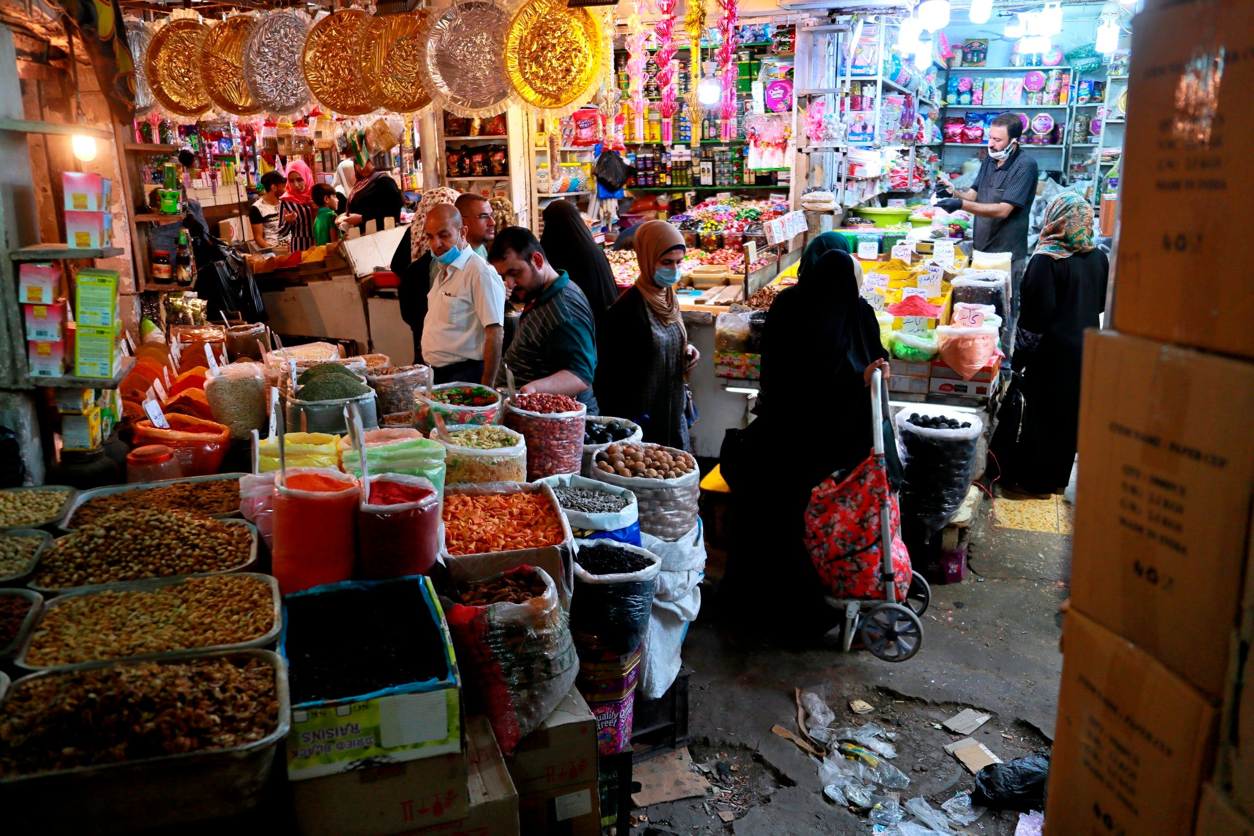 People shop in preparation for the Muslim fasting month of Ramadan, in Baghdad, Iraq, on Tuesday, April 21, 2020. (AP)