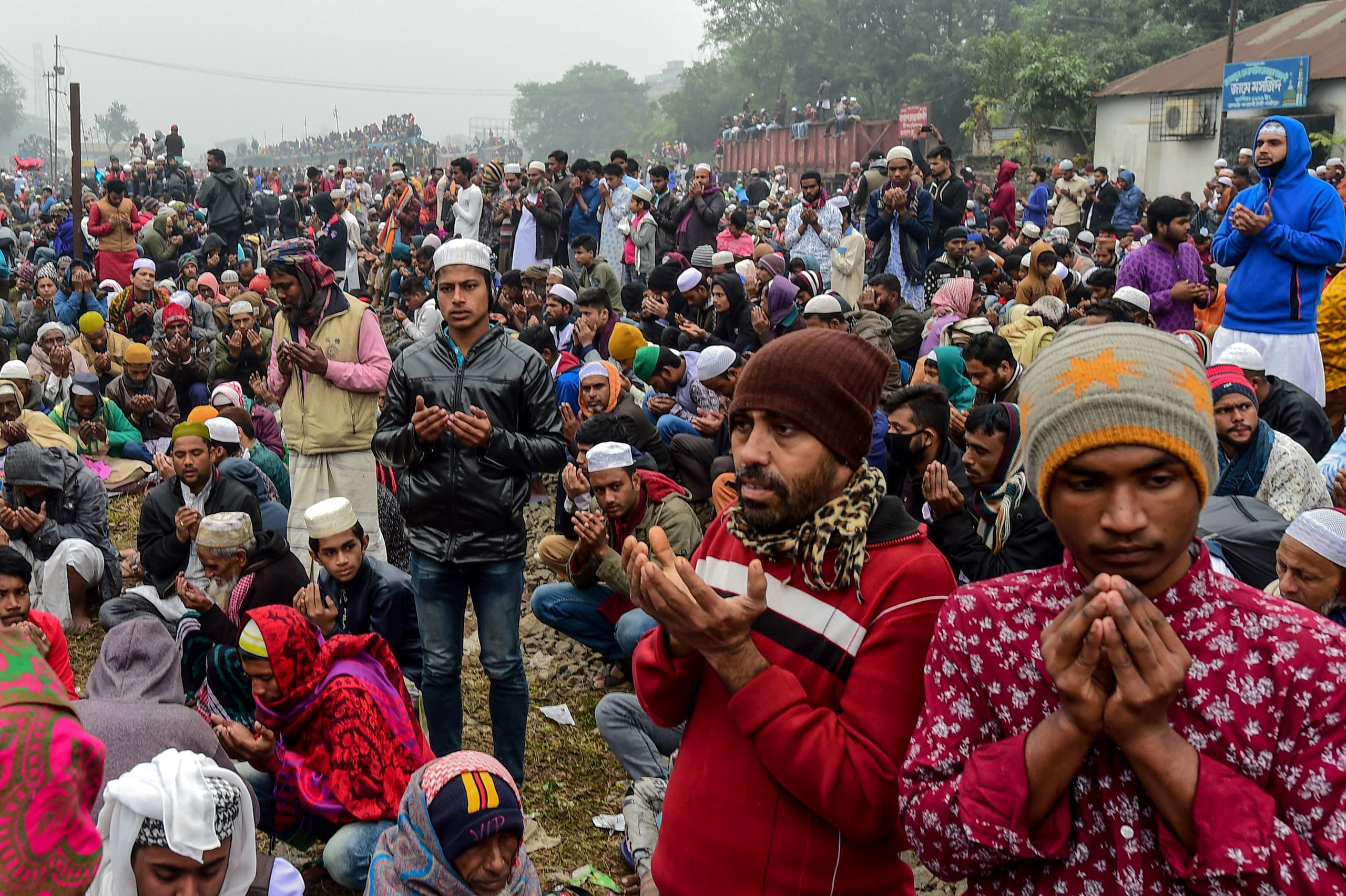 Muslim devotees take part in the Akheri Munajat, or final prayers, during the annual Muslim gathering 'Biswa Ijtema' in Tongi, some 30 kilometers north of Dhaka on January 12, 2020. (AFP)