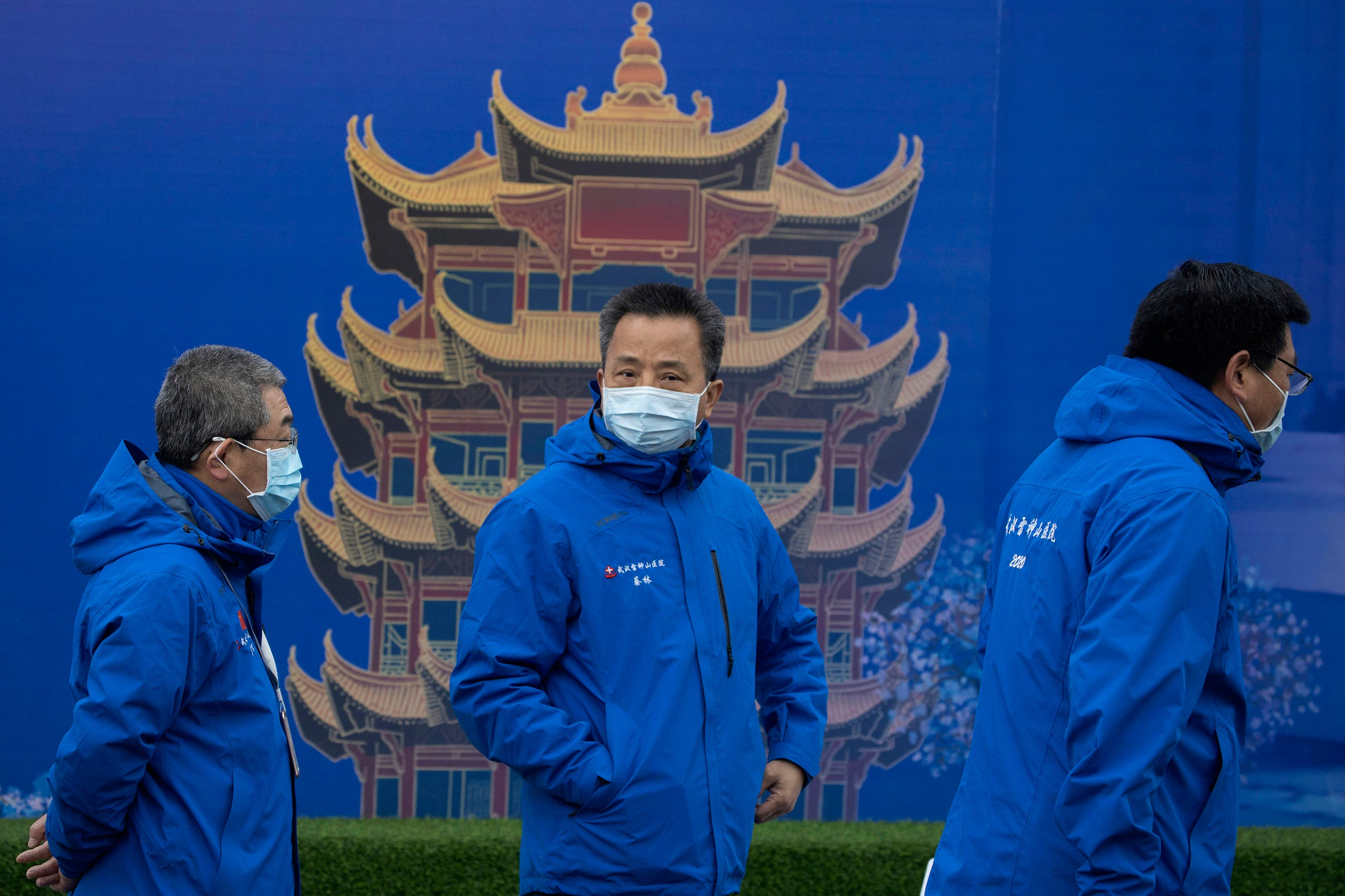 Doctors attend an outdoor press briefing at the Leishenshan Hospital, which was constructed in a parking lot from prefabricated modules in two weeks in Wuhan in China's Hubei province on April 11, 2020. (AP)